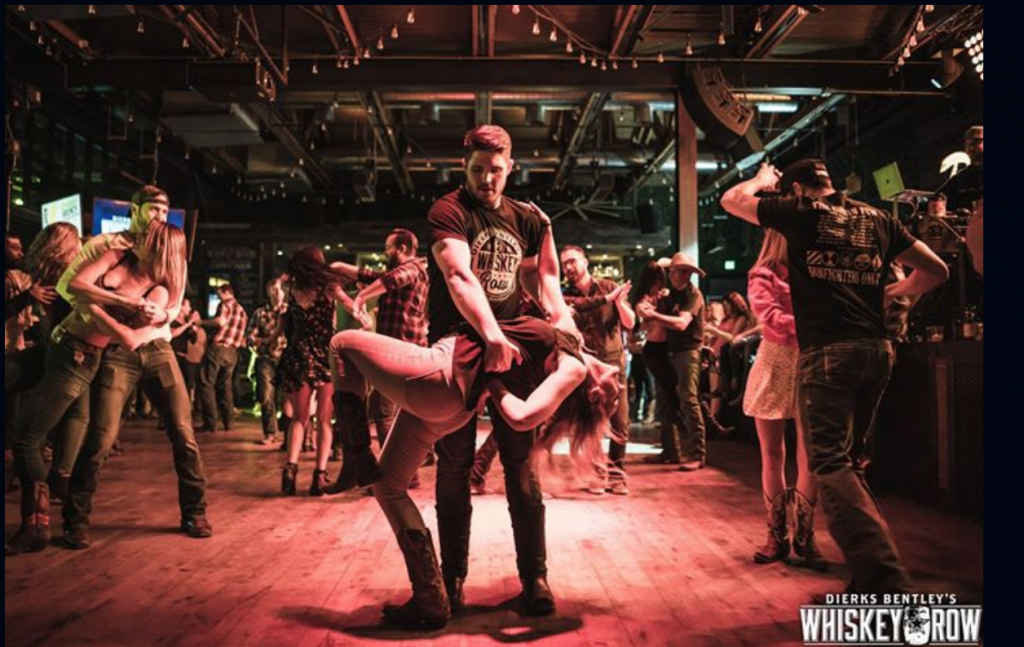 Learn how to line dance at a country-western night