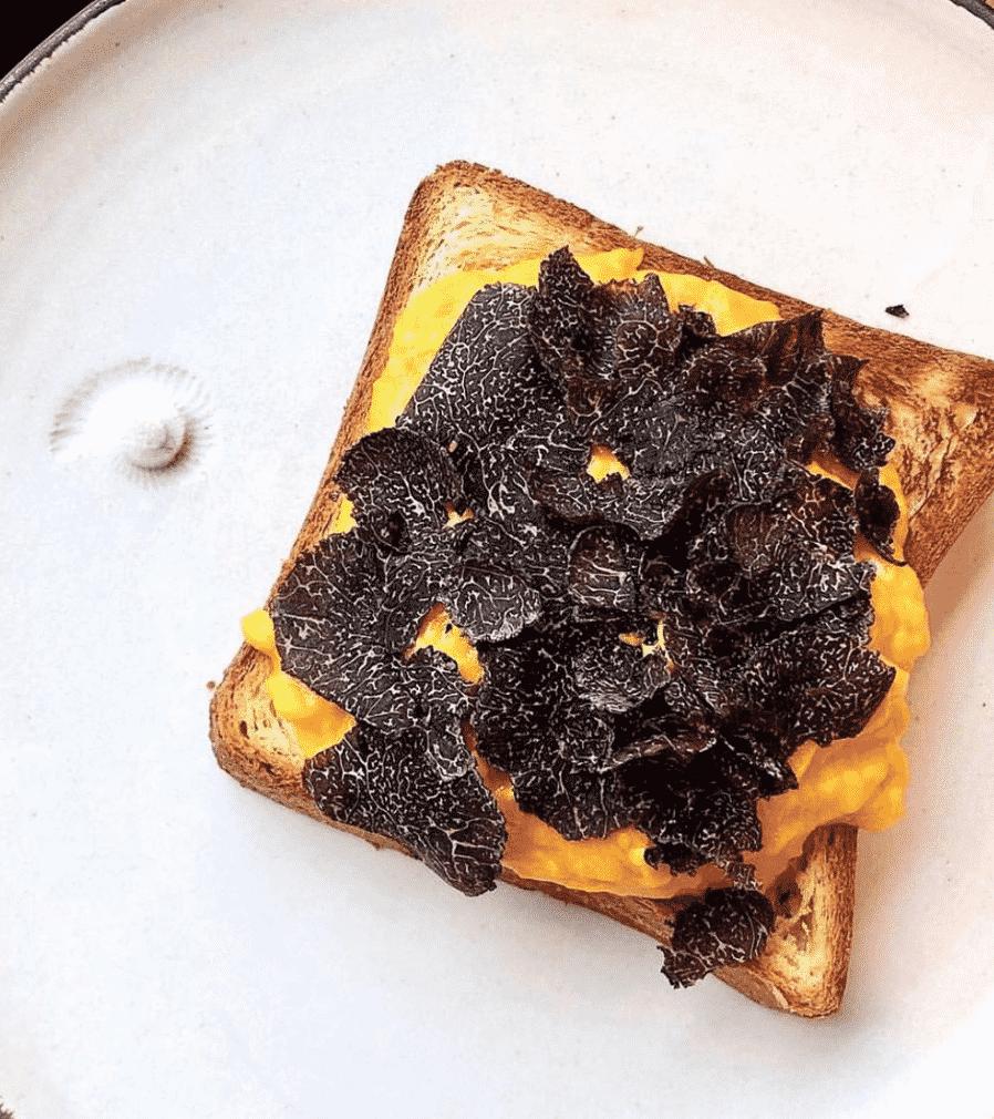Truffled Scrambled Eggs On Toast In London