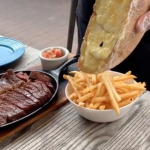 This Miami restaurant serves Steak with raclette fries