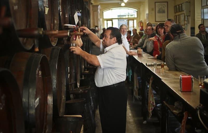 Serving Spanish Wine in Wooden Barrels