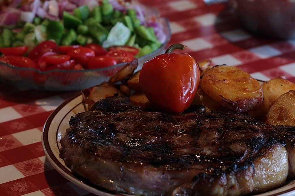 Best steakhouses new jersey arthur's tavern juicy steak on a plate with a salad