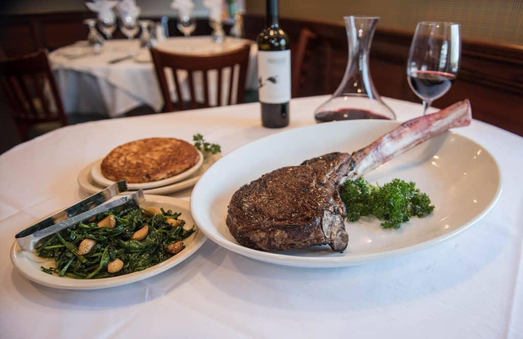 Best steakhouses new jersey the river palm t-bone steak on a plate