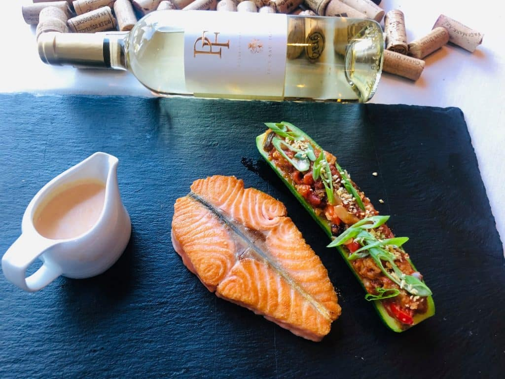 salmon and wine served in one of the best romantic restaurants houston