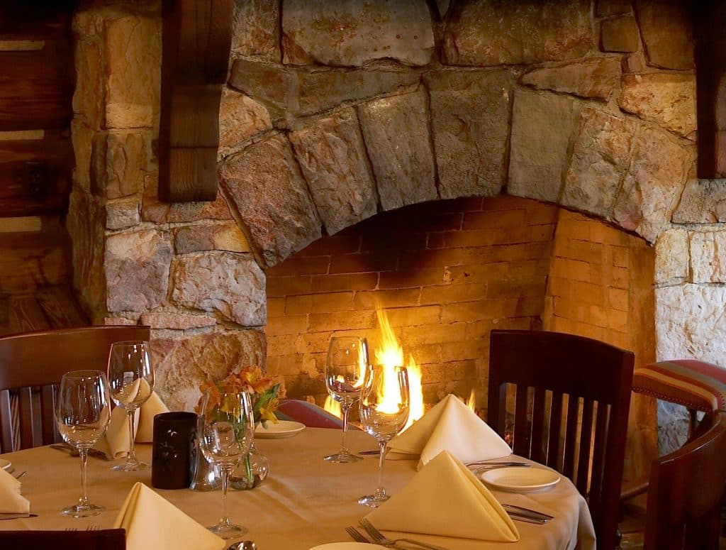 Fireside table in Rainbow Lodge Romantic Restaurant Houston Texas